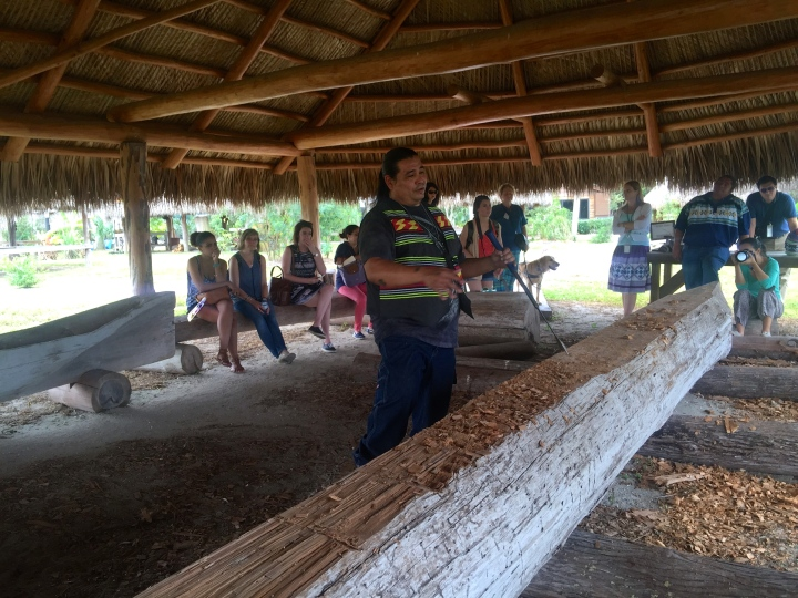 A Seminole man trying to keep the traditions alive by hand-carving a canoe using traditional methods (no power tools here)